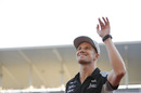 Nico Hulkenberg waves to fans with a smile on his face