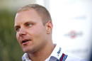 Valtteri Bottas speaks to media at the paddock
