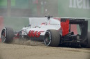 Romain Grosjean takes a trip through the gravel in FP1