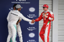 Lewis Hamilton and Kimi Raikkonen shake hands in parc ferme