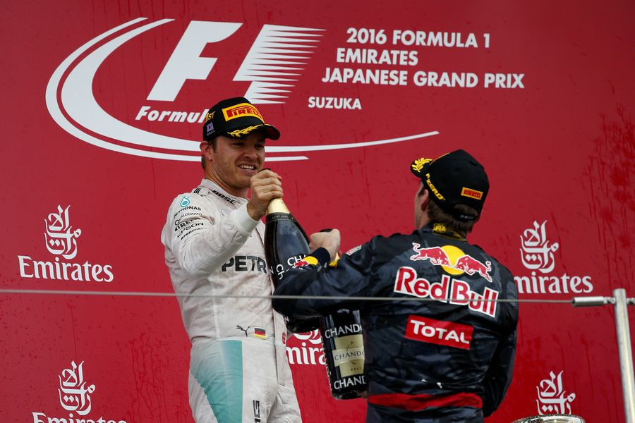 Nico Rosberg and Max Verstappen celebrate on the podium with the champagne