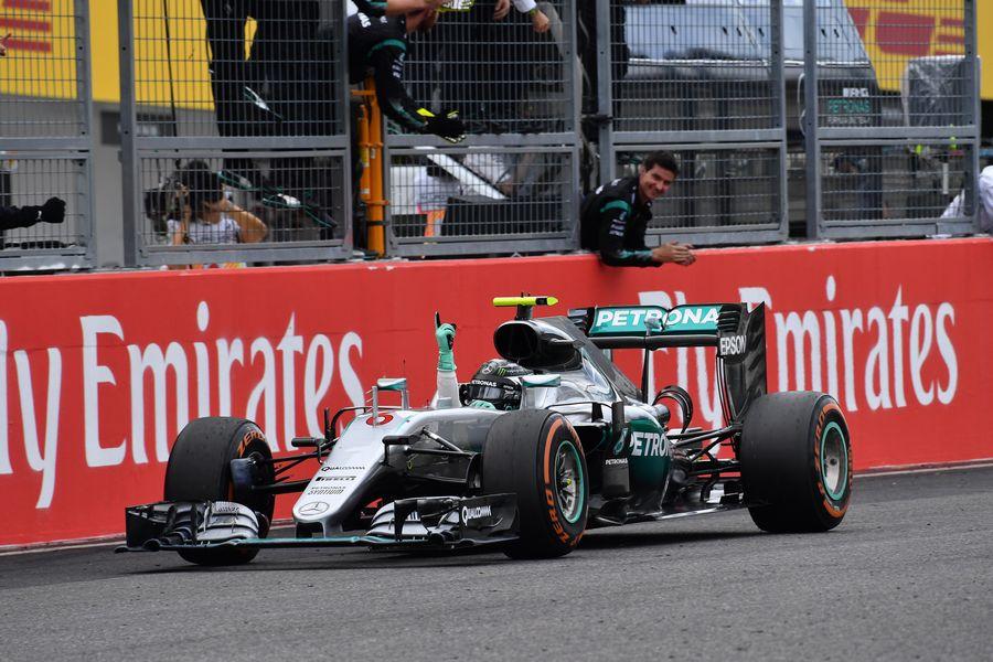 Nico Rosberg crosses the line