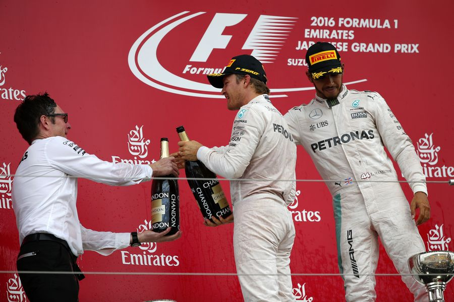 Mercedes celebrates on the podium with the champagne