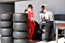 Ferrari mechanic and Pirelli technicians check tyres