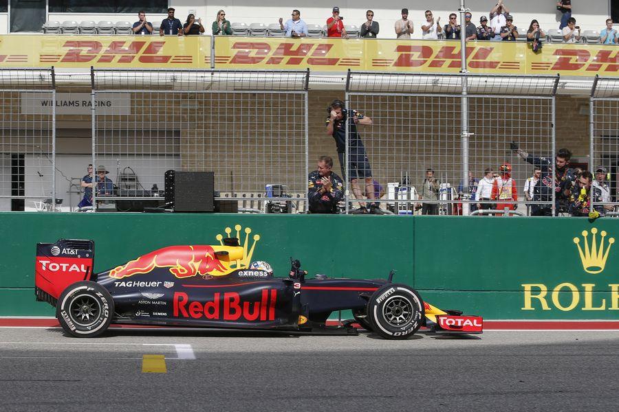 Daniel Ricciardo crosses the line for the third