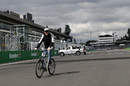 Nico Hulkenberg rides a bike