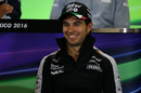 Sergio Perez smiles in the press conference