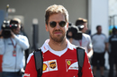 Sebastian Vettel walks through the paddock