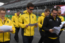 Jolyon Palmer walks the track with his engineers