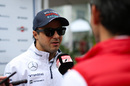 Felipe Massa speaks to media at the paddock