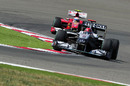 Michael Schumacher leads Fernando Alonso on a hot lap