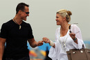 Michael Schumacher and his wife, Corinna, arrive in the paddock