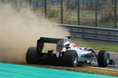 Michael Schumacher slides into the gravel at the end of qualifying