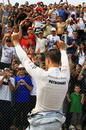 Michael Schumacher salutes the crowd after his exit