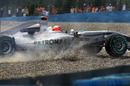 Michael Schumacher's Mercedes comes to a halt in the gravel