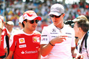 Felipe Massa and Michael Schumacher chat as they arrive for the race