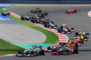 Michael Schumacher overtakes Jenson Button at the start of the Turkish Grand Prix
