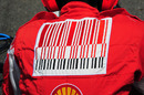 The controversial Marlboro bar-code logo on a Ferrari mechanic