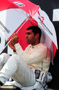 Karun Chandhok shelters from the sun before the race