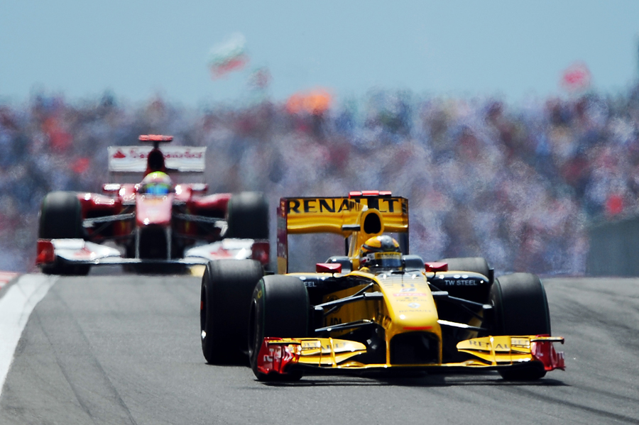 Vitaly Petrov leads Fernando Alonso shortly before the pair clashed