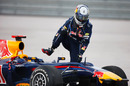 Sebastian Vettel climbs out his car after his collision with Mark Webber