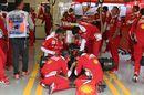 Ferrari mechanics works hard for Kimi Raikkonen's car