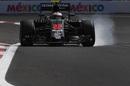 Jenson Button locks up heavily in the McLaren