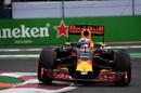 Daniel Ricciardo rides the kerb in his Red Bull