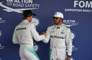 Lewis Hamilton and Nico Rosberg in parc ferme after qualifying