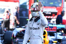 Lewis Hamilton celebrates taking pole position
