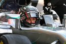 Nico Rosberg sits in the Mercedes cockpit