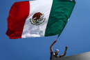 A fan waves Mexican flag