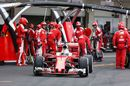 Sebastian Vettel makes a pit stop during the race