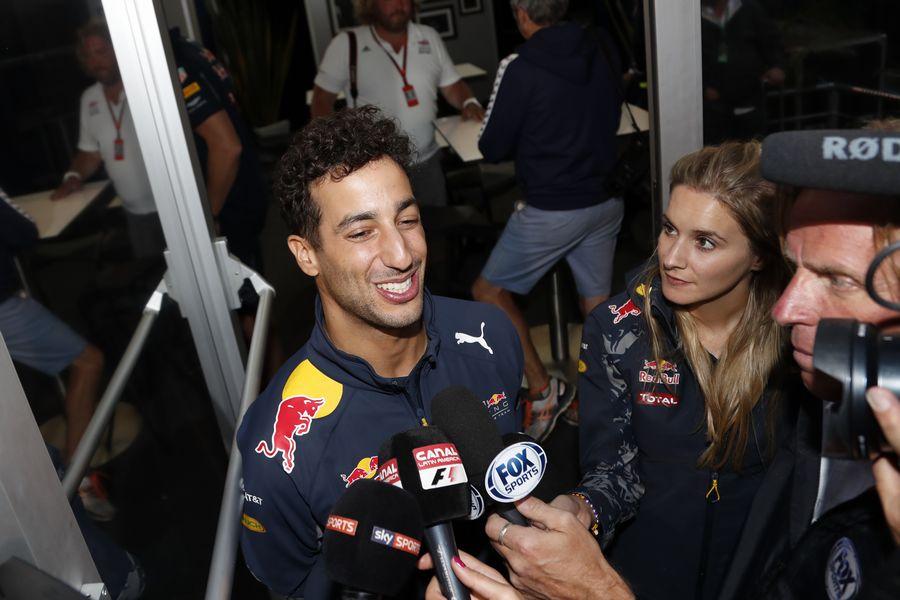 Daniel Ricciardo talks with the media having been awarded third place