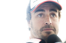 Fernando Alonso answers the questions in the paddock