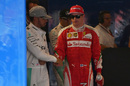 Lewis Hamilton and Kimi Raikkonen shake hands after qualifying