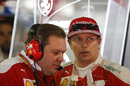 Kimi Raikkonen talks with Ferrari Race Engineer