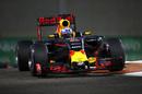 Daniel Ricciardo rides a kerb