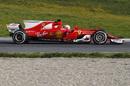 Sebastian Vettel focuses on his program in the Ferrari SF70-H