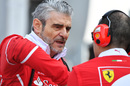 Maurizio Arrivabene talks with Ferrari engineers