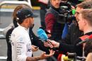 Lewis Hamilton talks with media