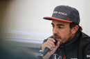 Fernando Alonso speaks with media after the session