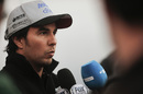 Sergio Perez answers questions from media
