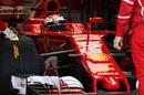 Kimi Raikkonen sits in the cockpit of Ferrari