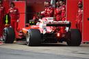 Sebastian Vettel makes a pit stop