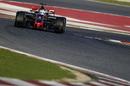 Romain Grosjean on track in the Haas