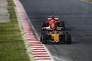Nico Hulkenberg in the Renault leads Kimi Raikkonen in the Ferrari