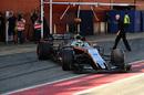 Sergio Perez leaves the garage for his run