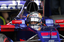 Carlos Sainz sits the cockpit of Toro Rosso