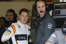 Stoffel Vandoorne talks with a McLaren mechanic